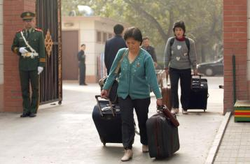 Can North Koreans leave? Two North Korean women leave the DPRK embassy in Beijing.