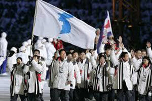 people waving The Unification Flag of North and South Korea