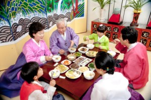 A Korean family enjoying a meal during Korean New Year.