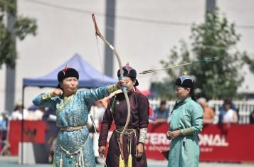 Mongolian archery: an archer looses an arrow at the Ulaanbaatar naadam.