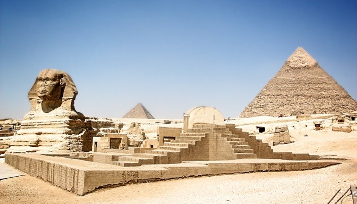 The Pyramids of Giza loom behind the Sphinx.