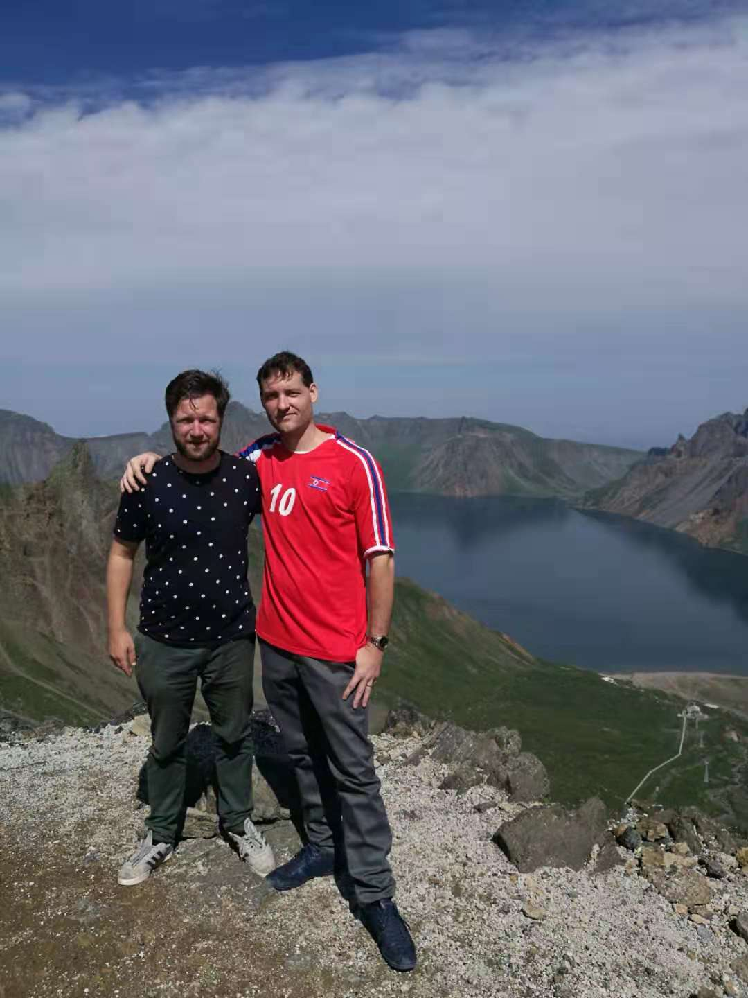 YPT Troy and Rik taking a photo by the top of Heaven's Lake, on Mt. Peakdu during the Korean Study Tour