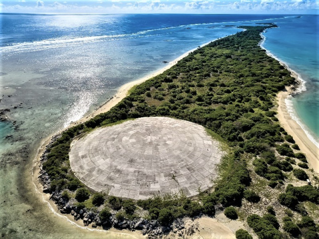 Worst islands: an overhead shot of the protective concrete dome placed over a heavily irradiated area of Enewetak Atoll, Marshall Islands.