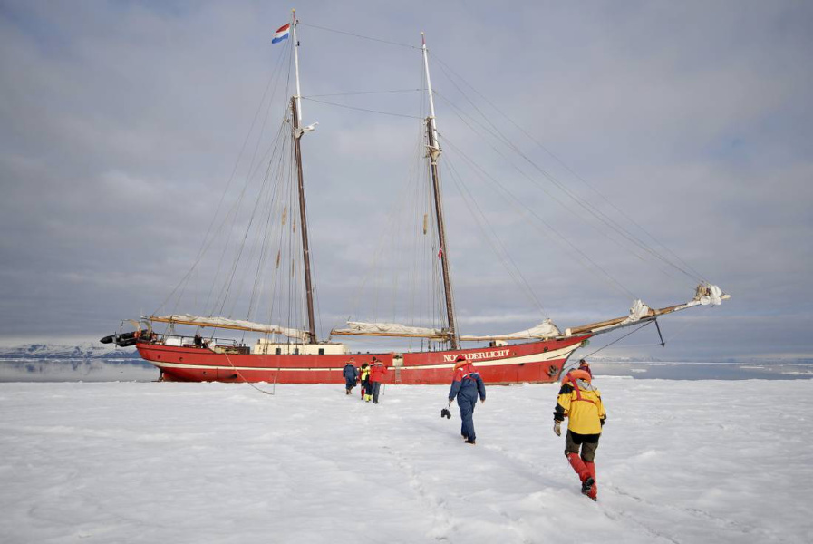 Overland tours: more of an overseas tour, as adventurers board their ship in the Arctic Ocean.