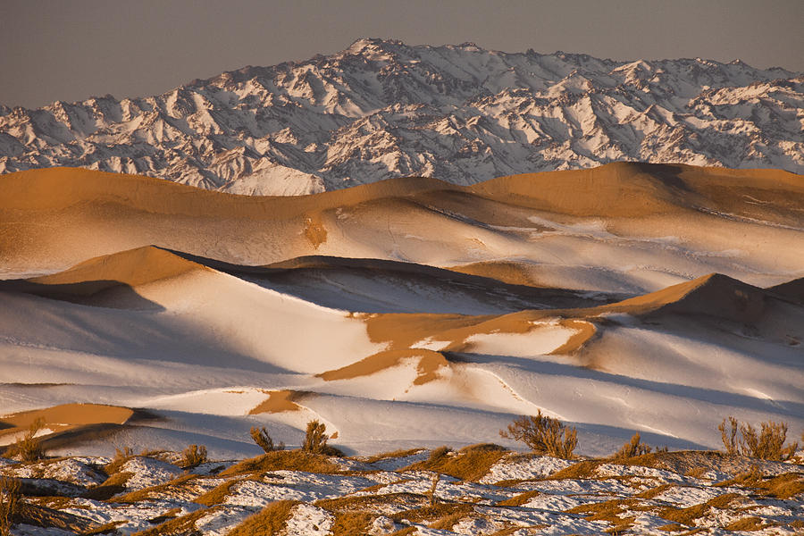 Frost sits on the dunes in the winter-time Gobi Desert.