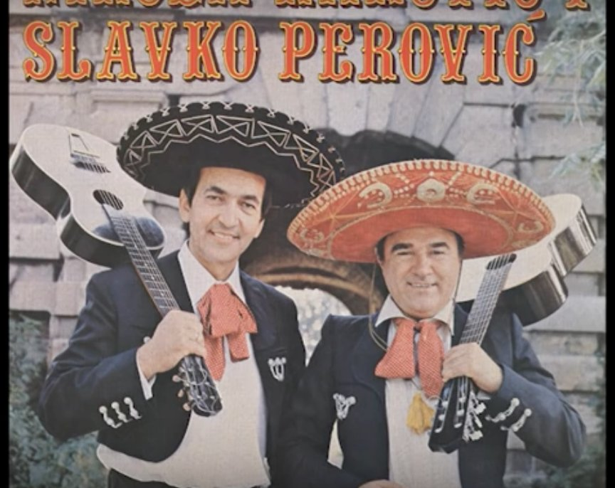 "Two Yugoslavians in traditional Mexican mariachi dress in 1950s Yugoslavia. The title reads ""slavko perovic""."
