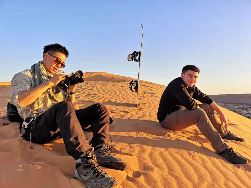 Sandboarding by the dunes of Taghit, in Algeria