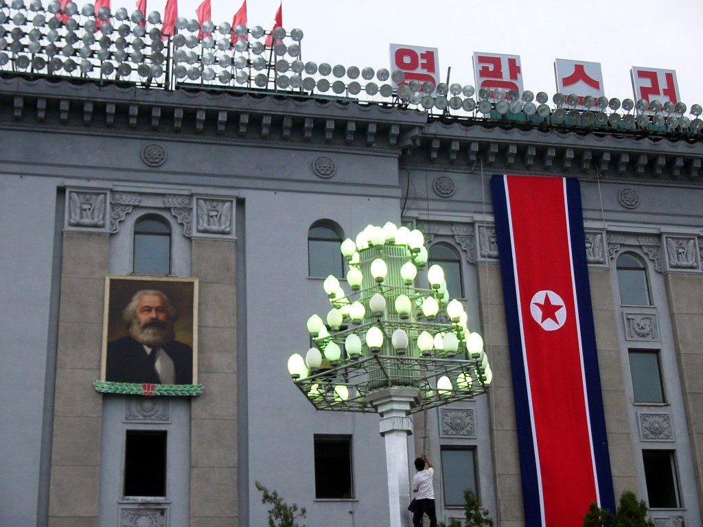 Old photo of Marx's portrait in Pyongyang, showing the link between Marxism and Juche.