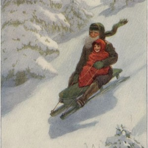 Childi and bearded man sledding down a hill