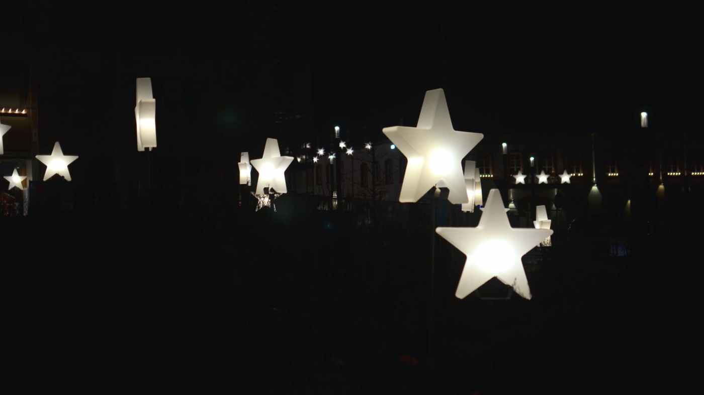 decorative star shaped garlands hanging on street at night