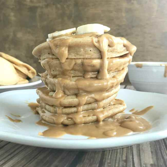 These Whole Wheat Peanut Butter Protein Pancakes satisfy your craving for comfort food (in a healthy way!) and keep you feeling full all morning long! | recipe via www.yourchoicenutrition.com