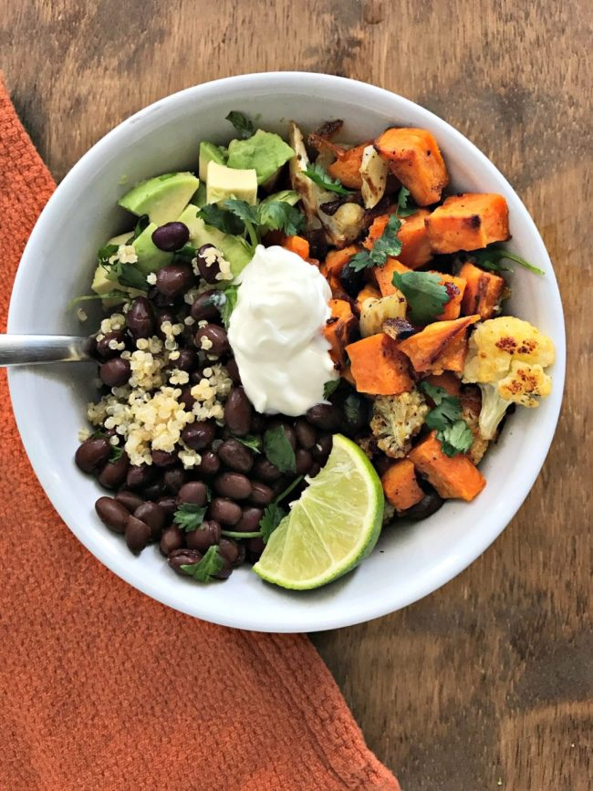 Roasted Sweet Potato & Cauliflower Power Bowl with black beans and quinoa. A bowl full of plant protein, fiber, and plenty of flavor! | recipe via www.yourchoicenutriiton.com