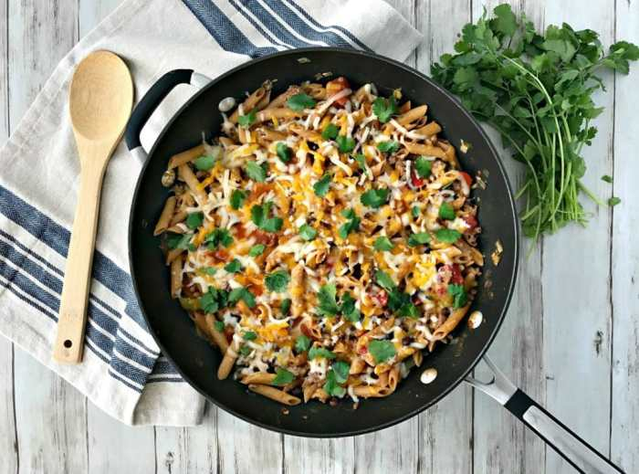 Switch up Taco Tuesday with this one-pan, healthy Taco Pasta Skillet meal! Easy to prepare and something the whole family will love! | recipe via www.yourchoicenutrition.com