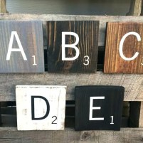Letter blocks A B C D and E finished with a variety of paint and stain colors
