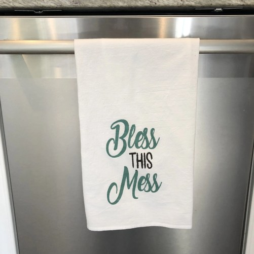 Towel with the phrase Bless this mess