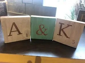 Wooden letter tiles with the phrase A & K