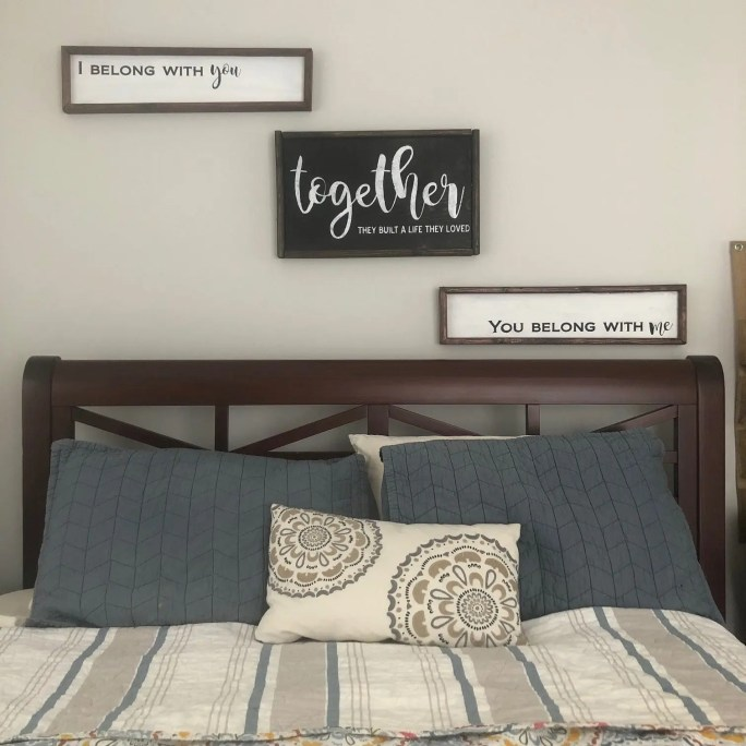 3 Framed wood signs shown as a set with the phrases I belong with you, together they built a life they loved, and you belong with me