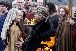 King Ecbert (Linus Roache) greets Princess Kwenthrith