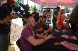 Alexander Ludwig and Travis Fimmel signing autographs