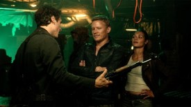 Julian tries to impress Noma and Alex with his big guns
