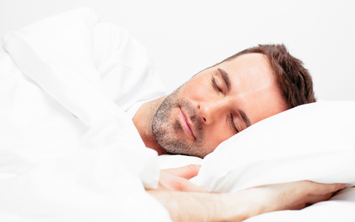 Man on left side sleep position with proper posture