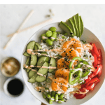 shrimp poke bowl with a side of soy sauce, ginger, and chopsticks