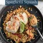 Thai peanut spaghetti squash on a dark gray plate with a fork full.