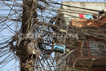 depositphotos_13370494-tangled-electric-cables
