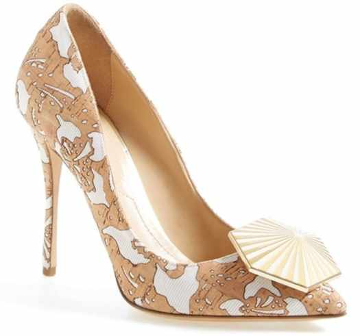 Enameled geometric hardware shines at the toe of a quintessential pump featuring laser-cut floral patterns that provide a dramatic, romantic finishing touch
