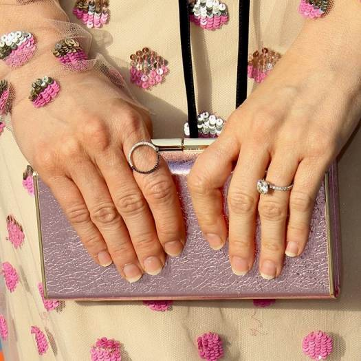 Brittany Snow's hands and pink Kate Spade New York 'Sam' box clutch