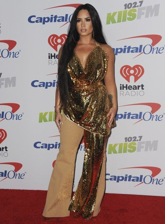 Demi Lovato completed her ensemble with big gold hoop earrings, a garish belt, and gold mirror leather 'Betty' platform sandals from Giuseppe Zanotti
