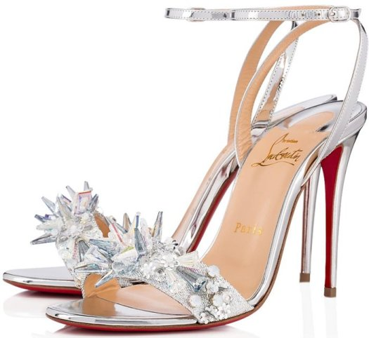 The Lurex toe strap features a variety of pearlescent and iridescent jewel-like ornaments