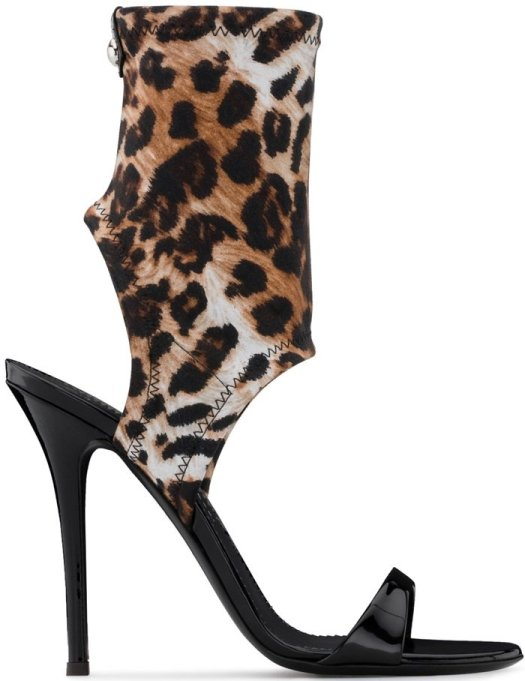 These ankle strap sandals feature a toe strap, a high stiletto heel, an open toe, an open heel, a branded insole, a leather sole, a leopard print stretch upper and a logo embossed at the sole