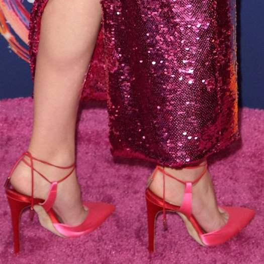 Lily Reinhart shows off her sexy feet in pointy-toe pink satin ankle-tie 'L'Attachante' pumps by Olgana Paris