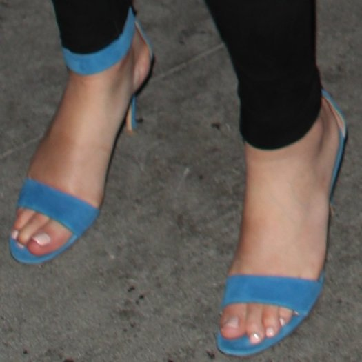 Sophia Hutchins shows off her feet in blue sandals
