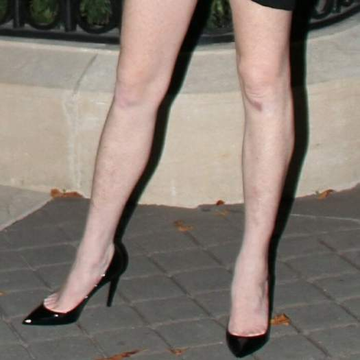 Lindsay Lohan had plenty of toe cleavage on show in pointy-toe Zoe patent-leather pumps