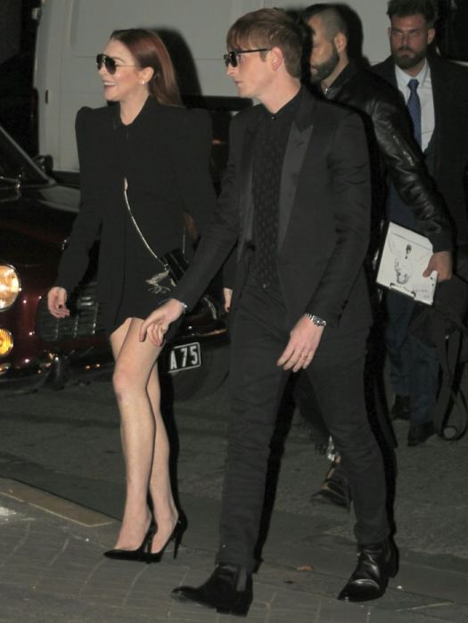 Lindsay Lohan flaunts her hot legs ina black high waisted 'Lavalliere' dress fromSaint Laurent