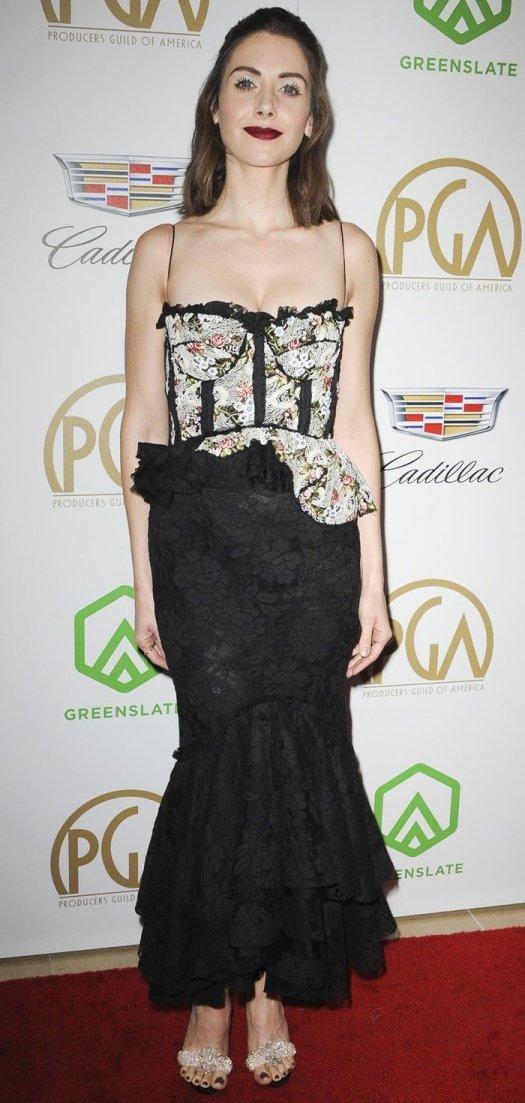 Alison Brie'sromantic black peplum ruffle gown