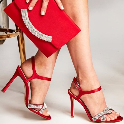 Twisted straps of rhinestone sparkle in these sexy red strappy satin evening Davia sandals