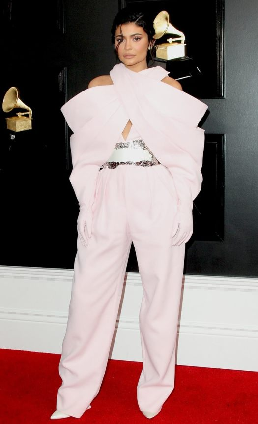 Kylie Jenner accessorized with Romy pumps by Jimmy Choo, pink gloves, and a bejeweled belt