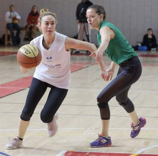 Actress Marta Hazas takes part in the Actresses vs. Ex-Players charitable women's basketball game at the Sports Facilities of the Canal de Madrid in Madrid on March 3, 2018