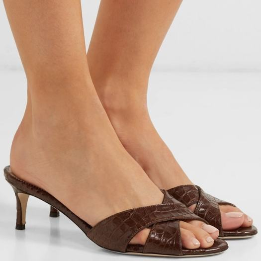 Set on a 50mm kitten heel, they've been made in Italy from croc-effect leather and have crisscross straps and elegant round toes.