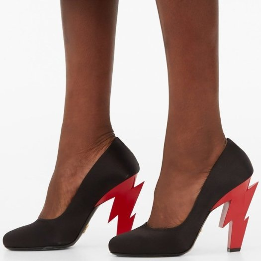 These shoes are cut from satin and set on a red lightning-bolt shaped heel