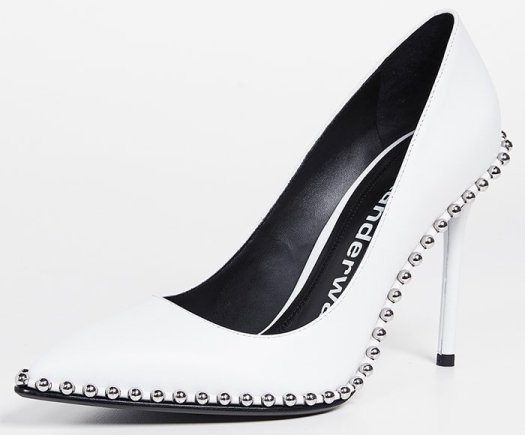 Silvery ball studs—an edgy detail seen in Alexander Wang's ready-to-wear collections—highlight the sharply pointed toe of this ultra-versatile stiletto