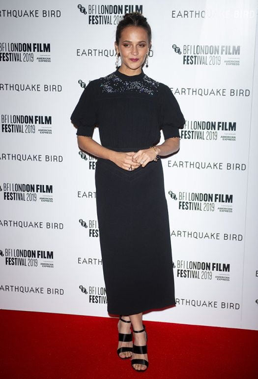 Alicia Vikander in a Louis Vuitton ensemble at the premiere of Earthquake Bird during the BFI London Film Festival at the Vue West End on October 10, 2019