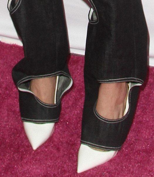 Cara Delevingne wears white pointy pumps