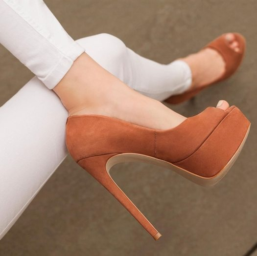 With a sky-high heel, flirty peep-toe, and smooth upper surfaces, this sexy pump is fit for a fierce femme fatale