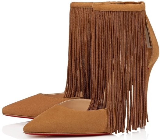 With details of timeless elegance such as a 100 mm stiletto heel and a tapered toe, its suede calf leather vamp is low cut and enhanced by a curtain of tassels that cascade from the thin ankle strap