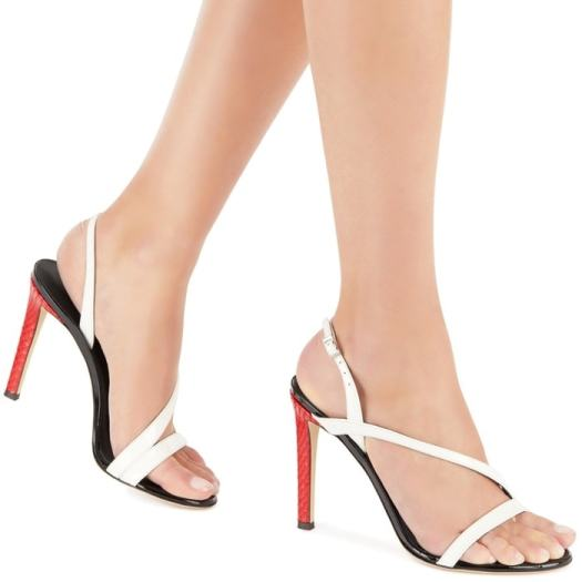 These high heel, patent white leather sandals are characterized by their cross strap