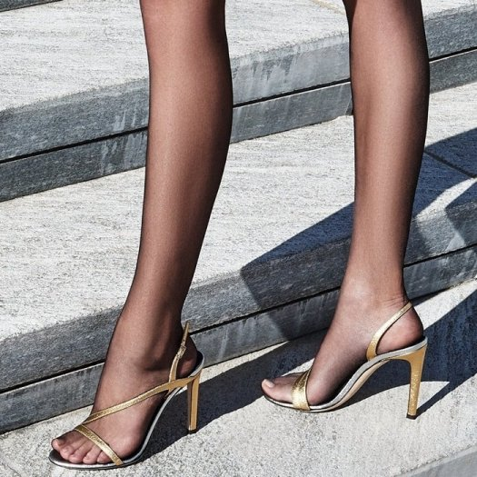 These high heel, laminated golden leather sandals feature a back strap in matching colour and a covered, laminated golden leather heel